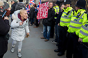 On the day that the UK was scheduled to leave the European Union and political parties commence campaigning for the General Election on December 12th, a Brexiter woman shouts at police officers as Brexiters voice their anger outside the British parliament in Westminster, on 31st October 2019, in London, England.
