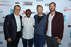 David Renzer, Troy Carter, Justin Tranter and guest at Creative Community For Peace 2nd Annual 'Ambassadors Of Peace' Gala held at Los Angeles on September 26, 2019 in Private Residence, California, United States (Photo by © Jc Olivera/VipEventPhotography.com