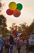 Banksy (right) unravels the string of his famous balloon girl at Glastonbury Festival 2005.