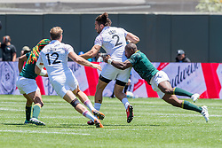 July 22, 2018 - San Francisco, CA, U.S. - SAN FRANCISCO, CA - JULY 22: A South African defender tackles England's Mike Ellery during the semifinal match between England and South Africa at the Rugby World Cup Sevens on July 22, 2018 at AT&T Park in San Francisco, CA. (Photo by Bob Kupbens/Icon Sportswire) (Credit Image: © Bob Kupbens/Icon SMI via ZUMA Press)