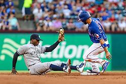 May 22, 2018 - Arlington, TX, U.S. - ARLINGTON, TX - MAY 22: New York Yankees shortstop Didi Gregorius (18) falls backward trying to tag Texas Rangers shortstop Isiah Kiner-Falefa (9) at second base during the game between the Texas Rangers and the New York Yankees on May 22, 2018 at Globe Life Park in Arlington, Texas. (Photo by Matthew Pearce/Icon Sportswire) (Credit Image: © Matthew Pearce/Icon SMI via ZUMA Press)