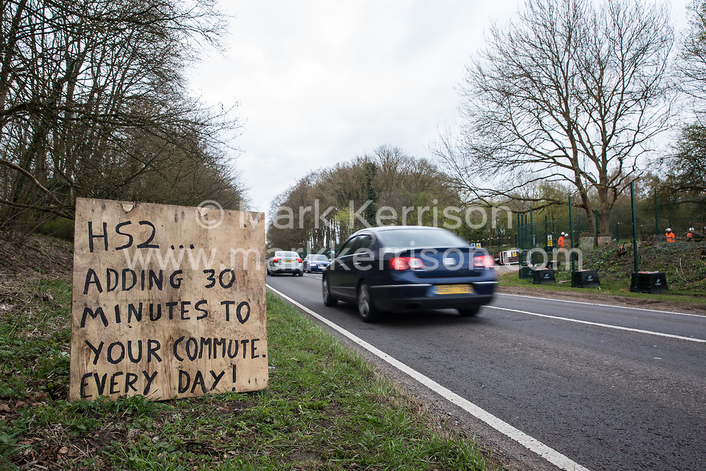 A sign outside Stop HS2's Wendover Active Resistance Camp referring to traffic delays on the A413 caused by tree felling works for the HS2 high-speed rail link on the opposite side of the road is pictured on 9th April 2021 in Wendover, United Kingdom. Tree felling work for the project is now taking place at several locations between Great Missenden and Wendover in the Chilterns AONB, including at Jones Hill Wood.