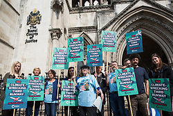 London, UK. 1st May, 2019. Campaigners gather outside the Royal Courts of Justice after the failure of a High Court challenge to the controversial plans to build a third runway at Heathrow airport. Judicial reviews of the Government's decision to approve the plans had been brought by five councils, residents, environmental charities including Greenpeace, Friends of the Earth and Plan B and London Mayor Sadiq Khan.