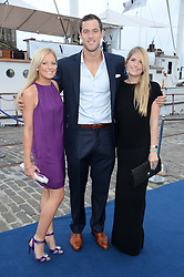 Johnnie Walker Gold Label Reserve Finale Celebration Party aboard the John Walker & Sons Voyager moored at the Prince of Wales Docks, Leith, Edinburgh, Scotland on 14th August 2013.<br /> Picture shows:-Left to right, Laura Visser, Scottish Rugby Player Tim Visser and Becky Davy.