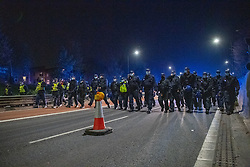 © Licensed to London News Pictures. 03/04/2021. Bristol, UK. Police form a line to move protesters off the M32 during the 'Kill the Bill' demonstration in Bristol. Crowds gathered to protest against the proposed Police, Crime, Sentencing and Courts Bill. Photo credit: Peter Manning/LNP