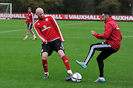 Wales players James Collins (l) and Neil Taylor during Wales football team training at Hensol Castle, Vale of Glamorgan, South Wales on Tuesday 10th November 2015. the team are training ahead of their friendly against the Netherlands on Friday,<br /> pic by  Andrew Orchard, Andrew Orchard sports photography.