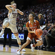 UNCASVILLE, CONNECTICUT- DECEMBER 4:  Brooke McCarty #11 of the Texas Longhorns prepares to shoot while defended by Katie Lou Samuelson #33 of the Connecticut Huskies during the UConn Huskies Vs Texas Longhorns, NCAA Women's Basketball game in the Jimmy V Classic on December 4th, 2016 at the Mohegan Sun Arena, Uncasville, Connecticut. (Photo by Tim Clayton/Corbis via Getty Images)