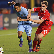 Gaël Clichy, (left), Manchester City, is held by Joe Allen, Liverpool, during the Manchester City Vs Liverpool FC Guinness International Champions Cup match at Yankee Stadium, The Bronx, New York, USA. 30th July 2014. Photo Tim Clayton