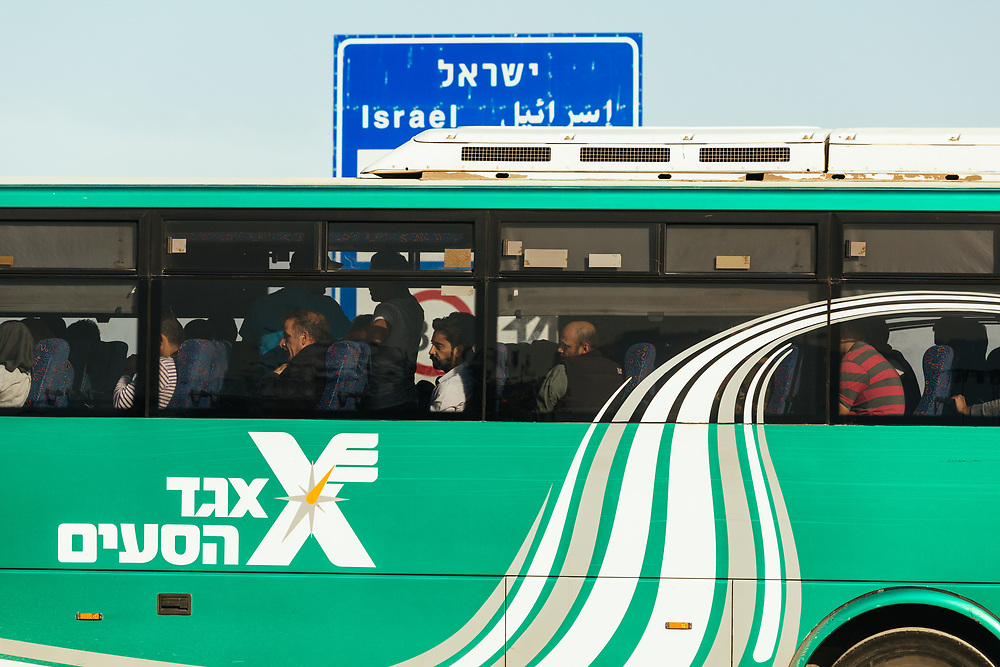 Jordanian workers are seen on a bus transporting them to various hotels where they work in Eilat, outside the Yitzhak Rabin Border Terminal, southern Israel, after crossing the border from Jordan into Israel, on March 15, 2018.