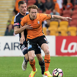 BRISBANE, AUSTRALIA - OCTOBER 7: Corey Brown of the Roar and James Troisi of the Victory compete for the ball during the round 1 Hyundai A-League match between the Brisbane Roar and Melbourne Victory at Suncorp Stadium on October 7, 2016 in Brisbane, Australia. (Photo by Patrick Kearney/Brisbane Roar)