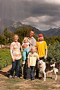 """Jill and Dave Bell, owners of Bell Organic Gardens, with their children Anna, Reid, Max, and dog """"Boo"""" at their farming operation in Sandy Utah."""