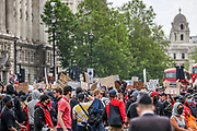Protesters stand in the road and block busses during a demonstration in Parliament Square in London on Wednesday, June 3, 2020, over the death of George Floyd, a black man who died after being restrained by Minneapolis police officers on May 25. Protests have taken place across America and internationally, after a white Minneapolis police officer pressed his knee against Floyd's neck while the handcuffed black man called out that he couldn't breathe. The officer, Derek Chauvin, has been fired and charged with murder. (Photo/ Vudi Xhymshiti)