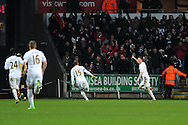 Swansea city's Ben Davies (r) celebrates after he scores the 1st goal. Barclays premier league, Swansea city v Stoke city at the Liberty Stadium in Swansea on Saturday 19th Jan 2013. pic by Andrew Orchard, Andrew Orchard sports photography,