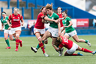 Jenny Murphy of Ireland runs through the tackles of Rachel Taylor (l) and Dyddgu Hywel (r) of Wales.<br /> RBS Womens Six Nations 2017 international rugby, Wales women v Ireland women at the BT Sport Cardiff Arms Park in Cardiff , South Wales on Saturday 11th March 2017.  pic by Simon Latham, Andrew Orchard sports photography