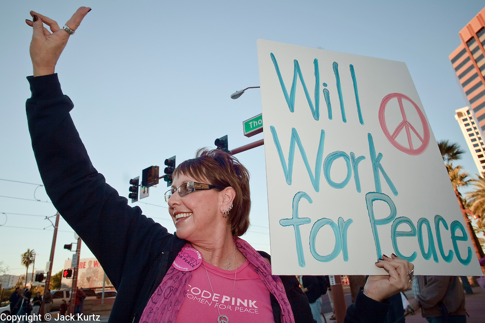30 DECEMBER 2008 -- PHOENIX, AZ: LISA BLANK, from Phoenix, a member of Code Pink, flashes the peace sign at an intersection in Phoenix Tuesday. About 200 people from a variety of human rights and peace activists organizations in Phoenix, AZ, marched in opposition to the Israeli attacks on Gaza and in favor of Palestinian rights on Tuesday, the fourth day of Israeli air strikes on Hamas facilities in Gaza. Photo by Jack Kurtz / ZUMA Press