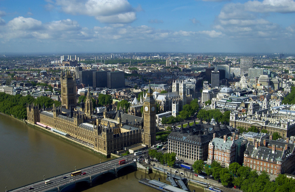 Aerial view of landmarks Big Ben, the Houses of Parliament, River Thames and a Red London Bus, Westminster Bridge, London, UK