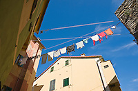 Clothing hangs to dry between buildings, Camogli, Liguria, Italy