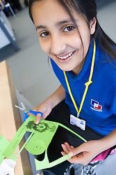 Secondary Asian School girl making a mechanism in Technology Class,