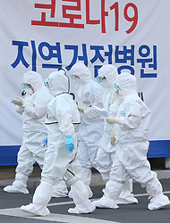 March 17, 2020, Daegu, South Korea: New coronavirus Medical workers in protective gear walk to begin a shift for the service of people infected with the new coronavirus at a hospital in the southeastern city of Daegu, the epicenter of South Korea's COVID-19 virus outbreak. (Credit Image: © Yonhap News/Newscom via ZUMA Press)