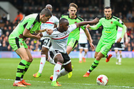 Neeskens Kebano of Fulham is being held by Danny Batth of Wolverhampton Wanderers during the Sky Bet Championship match at Craven Cottage, London<br /> Picture by Richard Brooks/Focus Images Ltd 07947656233<br /> 18/03/2017