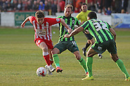 Sean Rigg of AFC Wimbledon challenges during the Sky Bet League 2 play-off second leg match between Accrington Stanley and AFC Wimbledon at the Fraser Eagle Stadium, Accrington, England on 18 May 2016. Photo by Pete Burns.