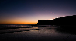 © Licensed to London News Pictures. 11/03/2014<br /> <br /> Saltburn by the Sea, England<br /> <br /> The skies are painted with amazing colours as dawn breaks over Huntcliff in Saltburn by the Sea in Cleveland.<br /> <br /> Photo credit : Ian Forsyth/LNP
