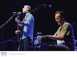 """Described as """"eclectic indie rockers sprinkled with desert dust"""", Calexico's musical sound is influenced by traditional sounds of Mexico and the south-western United States. The band's main members, Joey Burns and John Convertino, first played together in LA as part of the group Giant Sand. They have recorded many albums, and their 2005 release In the Reins, recorded with Iron and Wine, reached the Billboard 200 album charts."""
