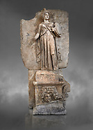 """Roman Sebasteion relief sculpture personifing a Balkan Warrior  Aphrodisias Museum, Aphrodisias, Turkey.  Against a grey background.<br /> <br /> The relief figure personifies a Balkan Warrior tribe defeated by Tiberius in AD 6-8 before he became emperor. She wears a classical dress, cloak and helmet and carries a small shield and probably once a spear. A builder's inscription, """"Pirouston"""", written above the shield, ensured the relief was put on the right base .<br /> <br /> If you prefer to buy from our ALAMY STOCK LIBRARY page at https://www.alamy.com/portfolio/paul-williams-funkystock/greco-roman-sculptures.html . Type -    Aphrodisias     - into LOWER SEARCH WITHIN GALLERY box - Refine search by adding a subject, place, background colour, museum etc.<br /> <br /> Visit our ROMAN WORLD PHOTO COLLECTIONS for more photos to download or buy as wall art prints https://funkystock.photoshelter.com/gallery-collection/The-Romans-Art-Artefacts-Antiquities-Historic-Sites-Pictures-Images/C0000r2uLJJo9_s0"""