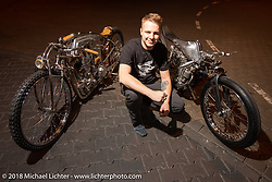 "Ziller's Garage's Dima Golubchikov of Russia after Dima got the first place win in the AMD Wolrd Championship of Custom Bike Building for his ""Insomnia"" custom Yamaha sr400 (also shown his award winning cafe racer) at the Intermot International Motorcycle Fair. Cologne, Germany. Sunday October 7, 2018. Photography ©2018 Michael Lichter."