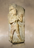Photo of Relief of God of War. Limestone, Kings Gate, Hattusa ( Bogazkoy ). 14th - 13th Century BC. Anatolian Civilisations Museum, Ankara, Turkey.<br /> <br /> The warrior depicted in high relief is dressed in a decorated skirt. The relief takes place on the interior part of the King's gate facing city, to the east of the city walls. He carries a crescent-handled short sword in his belt. The relief is identified as god depiction since the horns on the headdress are the indication of a god.<br /> <br /> Against a brown art background. .<br /> <br /> If you prefer to buy from our ALAMY PHOTO LIBRARY  Collection visit : https://www.alamy.com/portfolio/paul-williams-funkystock/hattusa-hittite-site-turkey.html - Type Kings Gate into the LOWER SEARCH WITHIN GALLERY box. Refine search by adding background colour, place, museum etc<br /> <br /> Visit our HITTITE PHOTO COLLECTIONS for more photos to download or buy as wall art prints https://funkystock.photoshelter.com/gallery-collection/The-Hittites-Art-Artefacts-Antiquities-Historic-Sites-Pictures-Images-of/C0000NUBSMhSc3Oo
