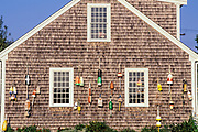 Buoys on the side of house, Truro, Cape Cod, Massachusetts, USA