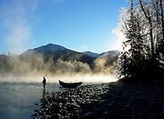 Alaska, upper Kenai River. Trout fisherman braves sub-zero temparatures on the search of Alaskan rainbow trout.