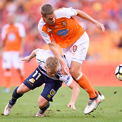 BRISBANE, AUSTRALIA - MARCH 31: Thomas Kristensen of the Roar and Connor Pain of the Mariners compete for the ball during the Round 25 Hyundai A-League match between Brisbane Roar and Central Coast Mariners on March 31, 2018 in Brisbane, Australia. (Photo by Patrick Kearney / Brisbane Roar FC)