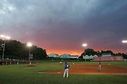 High school baseball game at sunset.