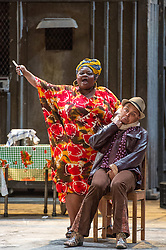 © Licensed to London News Pictures. 10/07/2012. Cape Town Opera return to the London Coliseum this July with their acclaimed production of Porgy and Bess.Picture shows: Miranda Tina (Maria) and Victor Ryan Robertson (Sporting Life) Photo credit : Tony Nandi/LNP
