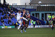 Tranmere Rovers' Steven Jennings clears the ball from Carlisle United's Brad Potts. Skybet football league 1 match, Tranmere Rovers v Carlisle United at Prenton Park in Birkenhead, England on Saturday 29th March 2014.<br /> pic by Chris Stading, Andrew Orchard sports photography.