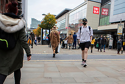 © Licensed to London News Pictures. 19/10/2020. Manchester, UK. A man wearing a face mask walks down Market Street, Manchester. Manchester is on the verge of a Tier 3 lockdown Photo credit: Kerry Elsworth/LNP