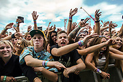 Big Day Out in Sydney 2014 the front crowd swaying to the music of Australian hip hop band Bliss N Eso on the red stage at Sydney Showgrounds.