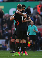 Liverpool's Ragnar Kloven and Emre Can celebrate their win. Premier league match, Stoke City v Liverpool at the Bet365 Stadium in Stoke on Trent, Staffs on Saturday 8th April 2017.<br /> pic by Bradley Collyer, Andrew Orchard sports photography.