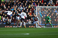 Everton's Samuel Eto'o (l) heads and scores his teams 1st goal. Barclays Premier league match, Burnley v Everton at Turf Moor in Burnley, Lancs on Sunday 26th October 2014.<br /> pic by Chris Stading, Andrew Orchard sports photography.