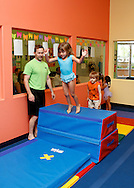 Jim Lark works with children at The Little Gym in Brentwood on Saturday, May 19, 2012.  (Photo by Kevin Bartram)