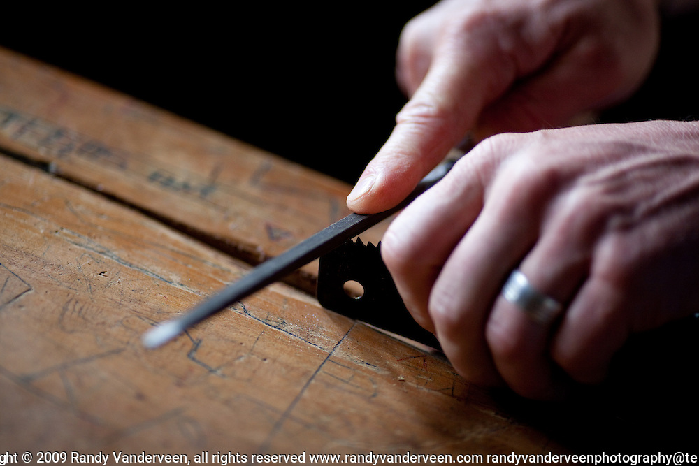 nyrasunge Rwanda.Photo Randy Vanderveen.Nyrusange, Rwanda.A hand saw is set and sharpened.