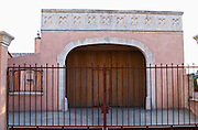 Chateau des Estanilles. In Lentheric village. Faugeres. Languedoc. The gate. A door. France. Europe.