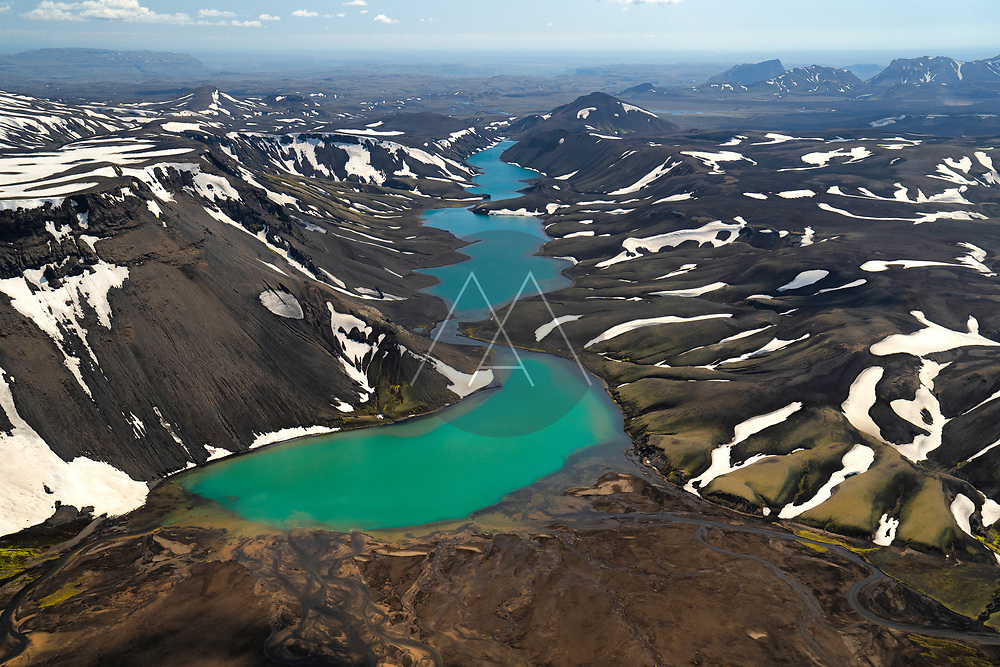 Aerial view of the Icelandic lake Hólmsárlón, in landmannalaugar, Iceland. As the summer starts creeping in, the snow begins to melt in the Icelandic Highlands.