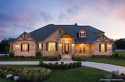 Front elevation of a custom ranch style home  for a Texas custom home builder