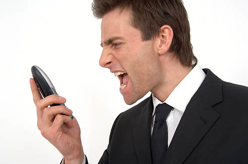 man yelling down the telephone<br />