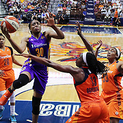 UNCASVILLE, CONNECTICUT- JULY 15:   Nneka Ogwumike #30 of the Los Angeles Sparks scores two points past her sister Chiney Ogwumike #13 of the Connecticut Sun during the Los Angeles Sparks Vs Connecticut Sun, WNBA regular season game at Mohegan Sun Arena on July 15, 2016 in Uncasville, Connecticut. (Photo by Tim Clayton/Corbis via Getty Images)