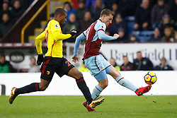 Burnley's Chris Wood (right) and Watford's Christian Kabasele battle for the ball during the Premier League match at Turf Moor, Burnley.