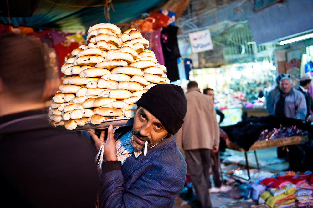 A man sells sweets in the Shourjah Market, Baghdad.