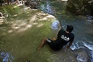 Indonesia, Lombok archipelago, Moyo island, rain forest, people in waterfall
